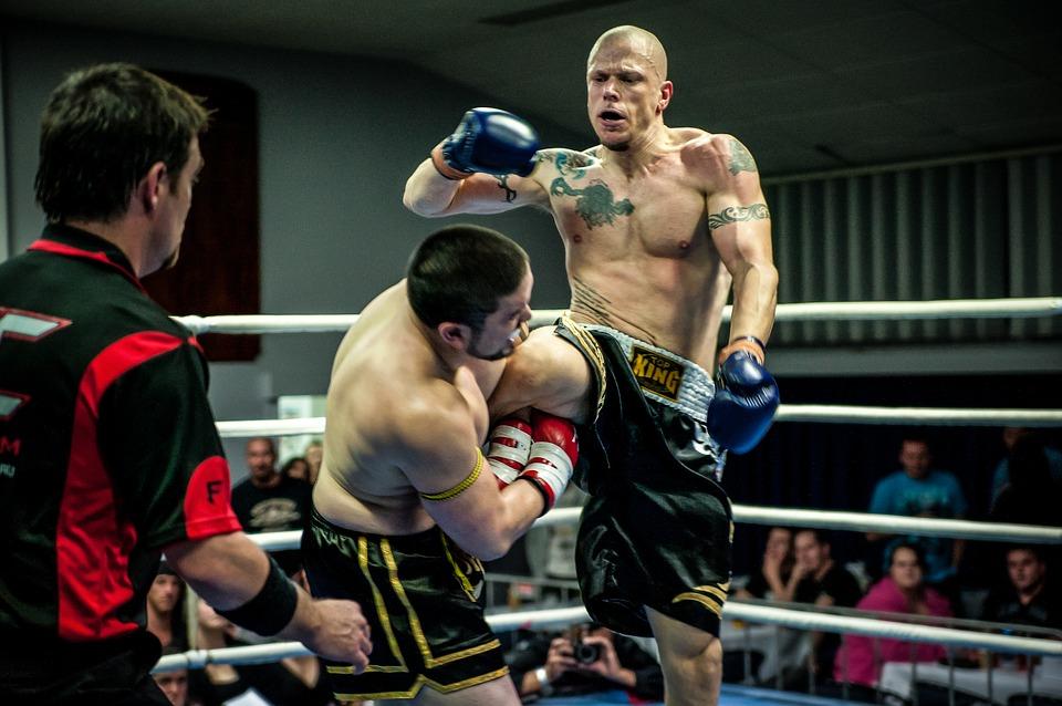 Two guys kickboxing.
